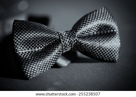 Close-up photo of black bow tie on dark background #255238507