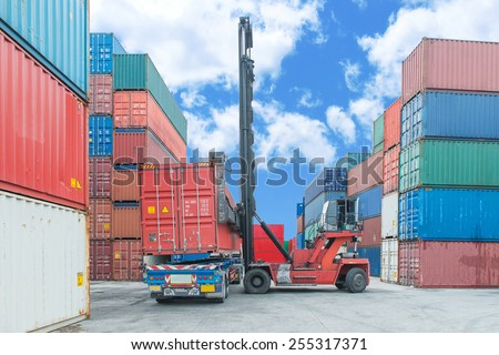Crane lifter handling container box loading to truck #255317371