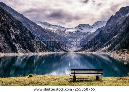 wooden bench at a reservoir in austria