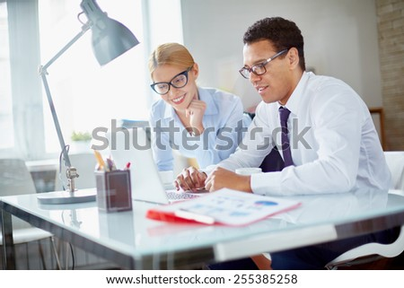 Charming secretary and her boss browsing data for new project at meeting #255385258