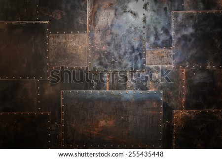 Scratched and spotted rusty metal background Royalty-Free Stock Photo #255435448