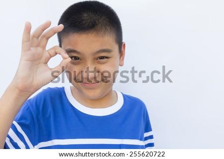 Boy with OK hand sign #255620722