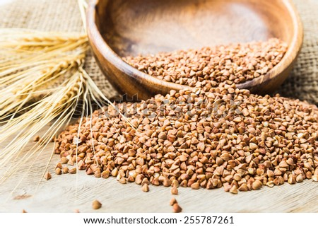 Bowl with Buckwheat on a wooden background #255787261
