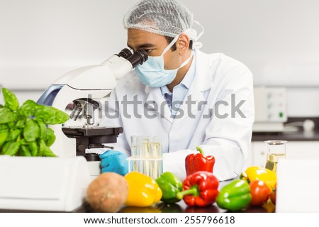 Food scientist using the microscope at the university #255796618