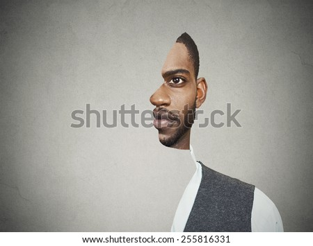 surrealistic portrait front with cut out profile of a young man isolated on grey wall background