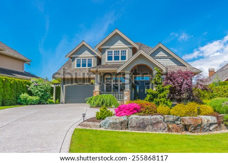 Big luxury custom made house with nicely landscaped front yard and driveway to garage in the suburb of Vancouver, Canada. #255868117