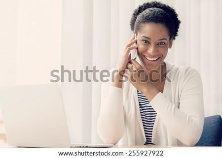Businesswoman using her mobile in offfice #255927922