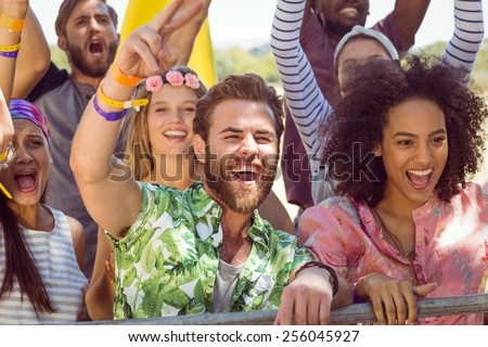 Excited young people singing along at a music festival #256045927