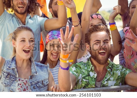 Excited young people singing along at a music festival #256101103