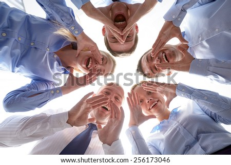 business, people and teamwork concept - smiling group of businesspeople standing in circle #256173046