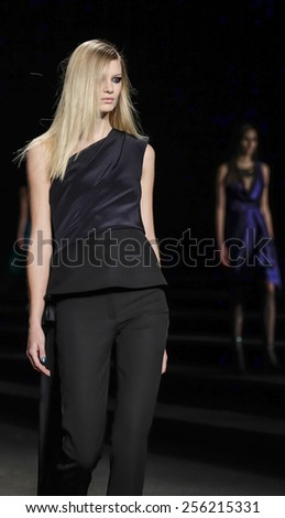 New York, NY, USA - February 13, 2015: A model walks runway for Monique Lhuillier Fall 2015 Runway show during Mercedes-Benz Fashion Week New York at the Theatre at Lincoln Center, Manhattan #256215331