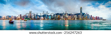 Hong Kong, China skyline panorama from across Victoria Harbor.