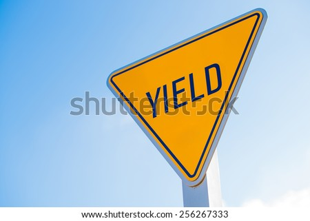 A yellow yield to surfer sign in southern California