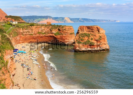 Dramtic red Jurassic cliffs and sea stacks  at Ladram Bay Devon England UK Europe Royalty-Free Stock Photo #256296559