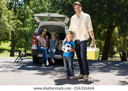 Happy family getting ready for road trip on a sunny day #256326664