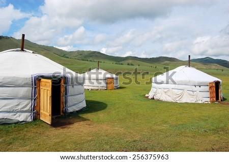 Little village of nomadic Yurt camp in the Mongolian Steppe at Terelj National Park #256375963