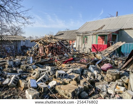 NIKISINO, UKRAINE - Feb 27, 2015: Ruined house. Village Nikishino located 20 km from Debaltseve, Ukrainian military was abandoned three days ago. Separatist forces attacked it for several days.  #256476802