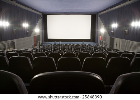 Empty cinema auditorium with line of chairs and stage with silver screen. Ready for adding your own picture. #25648390