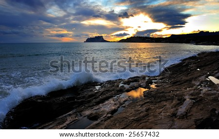 view of shoreline at dawn - long exposure image #25657432