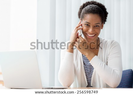 Businesswoman using her mobile in offfice #256598749