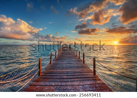 Bright sunset over sea pier #256693411