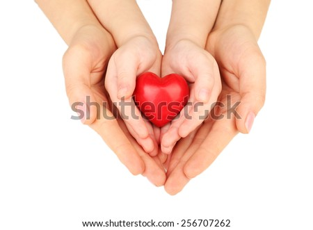 Heart in child and mother hands isolated on white #256707262