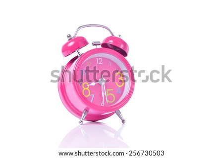 Pink vintage alarm clock isolated on white #256730503