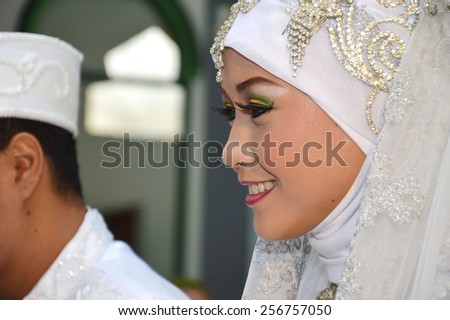 Indonesian bridal couples were undergoing the marriage ceremony event #256757050