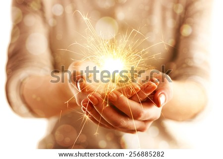 Hands with sparkler light isolated on white #256885282