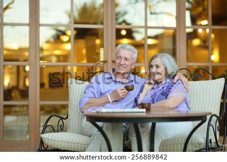 Senior couple drinking coffee outside at the resort during vacation #256889842