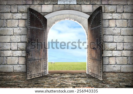 Beautiful view from arched passage.  Opening to a beautiful cloudy sky #256943335