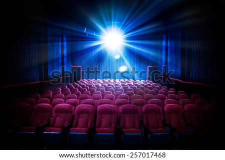 Movie Theater with empty seats and projector / High contrast image #257017468