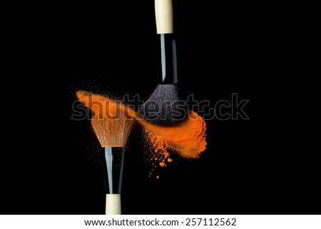 powderbrush on black background with blue powder splash  close up #257112562