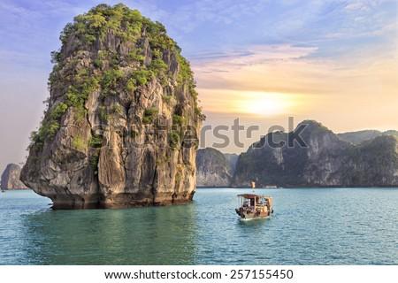 Dreamy sunset among the rocks of Halong Bay, Vietnam Royalty-Free Stock Photo #257155450