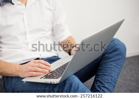 Young man working with laptop computer #257216122