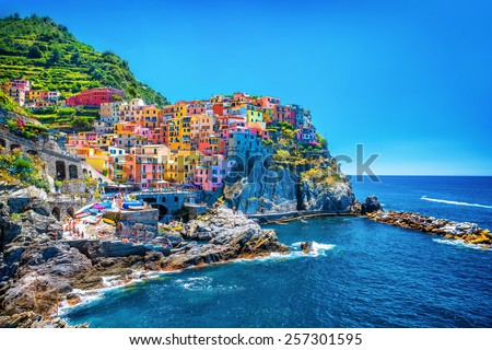 Beautiful colorful cityscape on the mountains over Mediterranean sea, Europe, Cinque Terre, traditional Italian architecture #257301595
