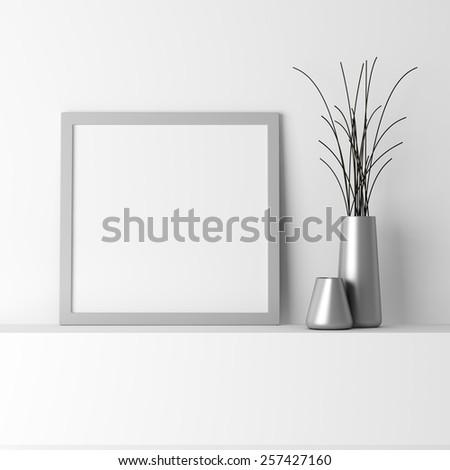 blank gray photo frame on white shelf #257427160