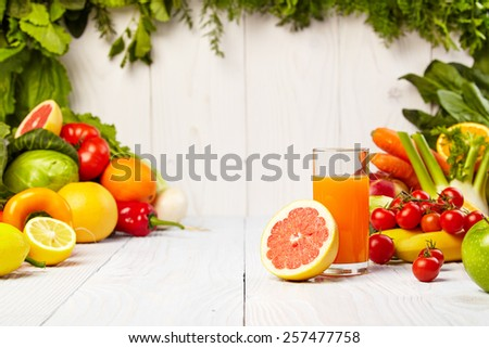 Fruit and vegetable borders Fruit and vegetable borders on wood table #257477758