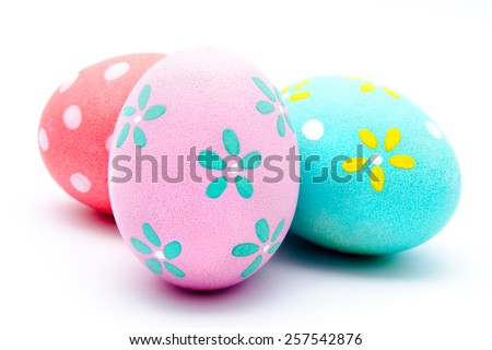 Three colorful handmade easter eggs isolated on a white Royalty-Free Stock Photo #257542876