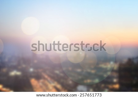 abstract double exposure of blurred sky night city downtown construction with circle round light background with lens flare effect concept. Royalty-Free Stock Photo #257651773