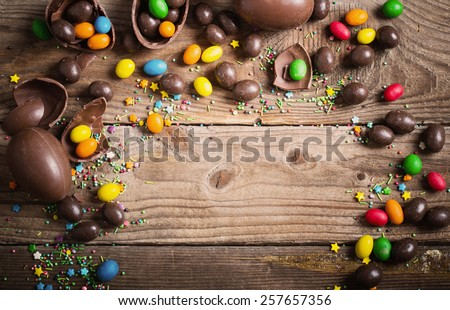 Chocolate Easter Eggs Over Wooden Background Royalty-Free Stock Photo #257657356