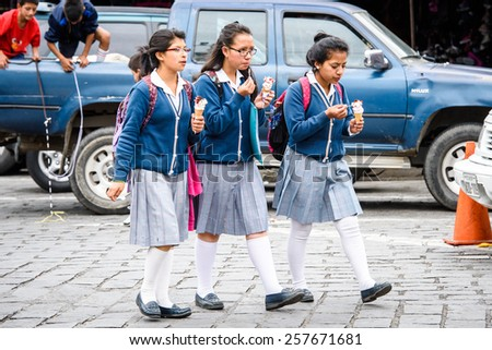 CUENCA, ECUADOR - JAN 9, 2015: Unidentified Ecuadorian girls walk in the street. 71,9% of Ecuadorian people belong to the Mestizo ethnic group #257671681