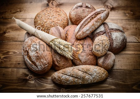 fresh bread  and wheat on the wooden #257677531