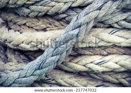 Gray nautical rope, closeup background texture, vintage toned photo with retro style filter Royalty-Free Stock Photo #257747032