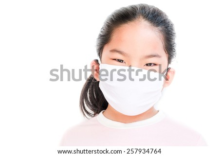 Girl with medicine protective masks isolated on white #257934764