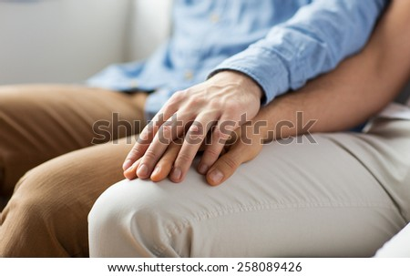 people, homosexuality, same-sex marriage, gay and love concept - close up of happy male gay couple holding hands #258089426