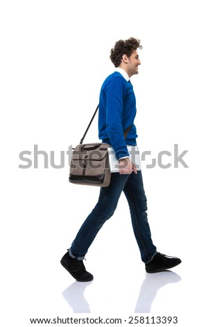 Man with bag walking over white background #258113393