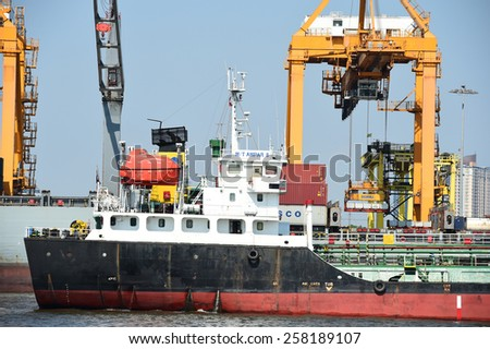 BANGKOK, February 26,2015: Port Authority of Thailand Klongtoey. The biggest port in Bangkok with loaded freight ship and cargo handling equipment on the side of Chao Phraya river. Bangkok,Thailand. #258189107