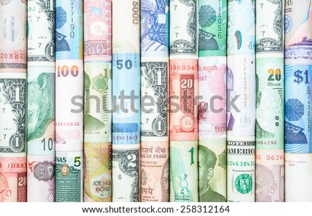 A backgrounds with colorful of many roll currency from many country Royalty-Free Stock Photo #258312164