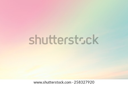 A soft cloud background with a pastel colored orange to blue gradient.